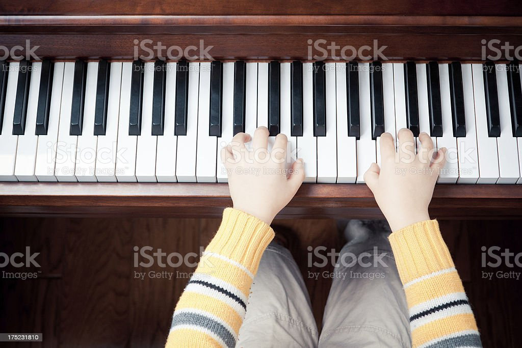 Playing a Piano (Child's hands) royalty-free stock photo
