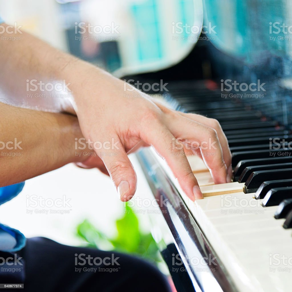 Playing a piano stock photo