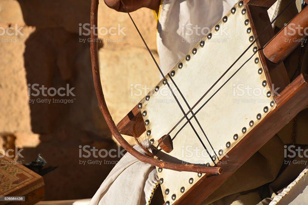 playing a rebab stock photo