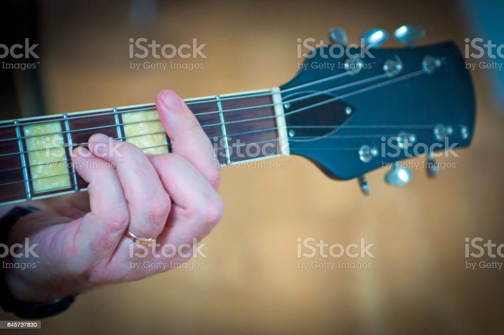 Playing a  semi acoustic guitar stock photo