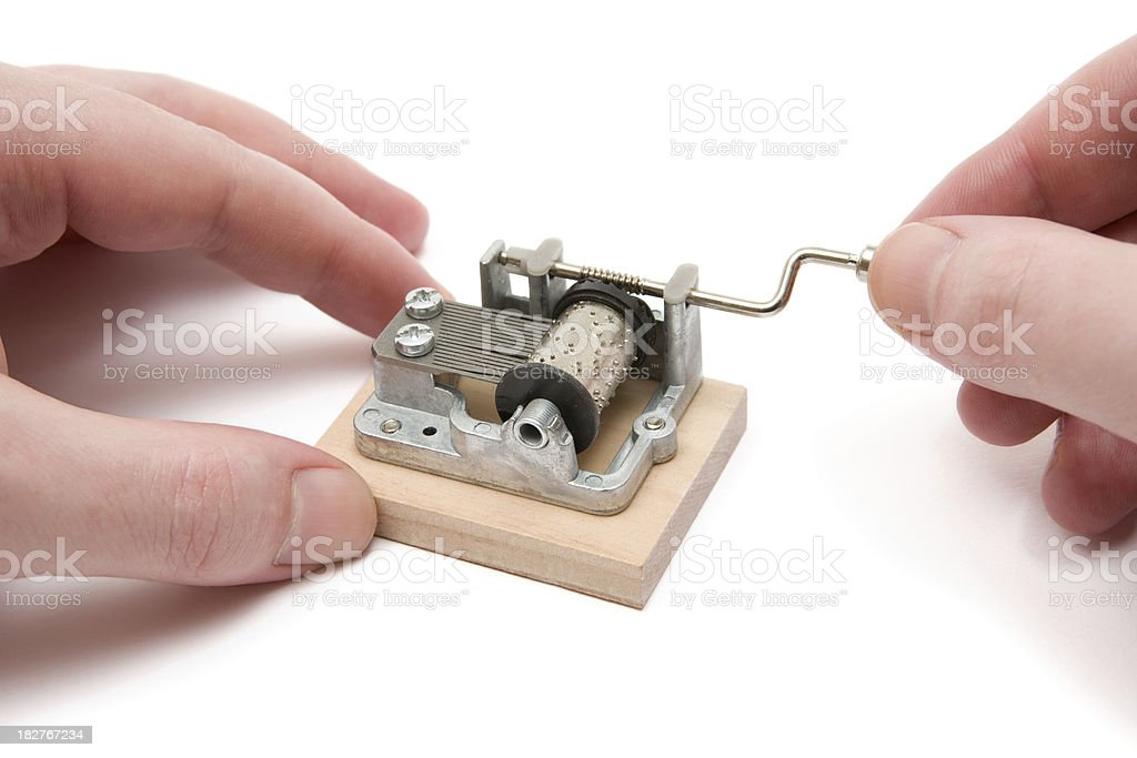 Playing a Small Music Box stock photo