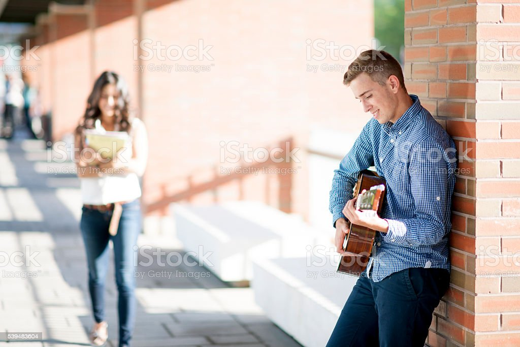 Playing a Song on a Guitar stock photo