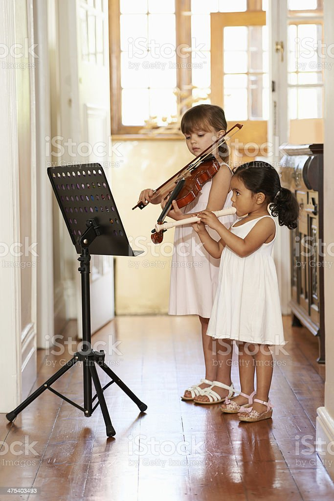 Playing a violin duet stock photo