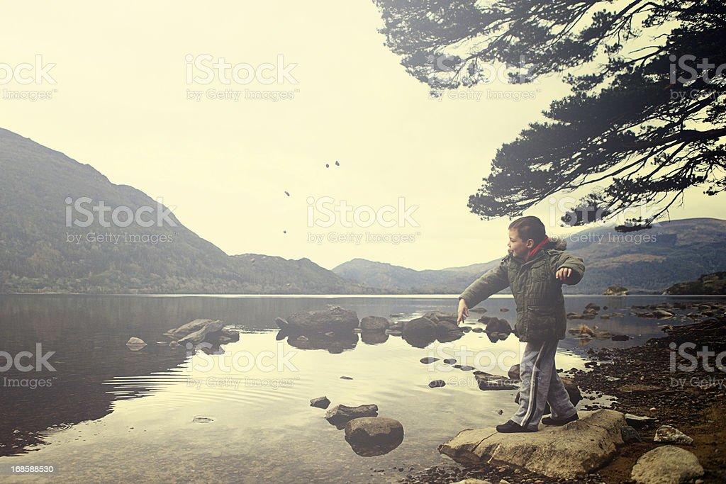playing at the lake stock photo