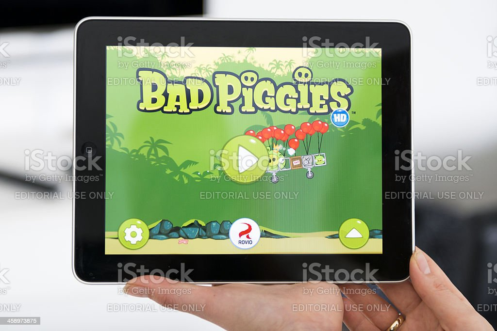 Playing Bad Piggies the succesor of Angry Birds royalty-free stock photo