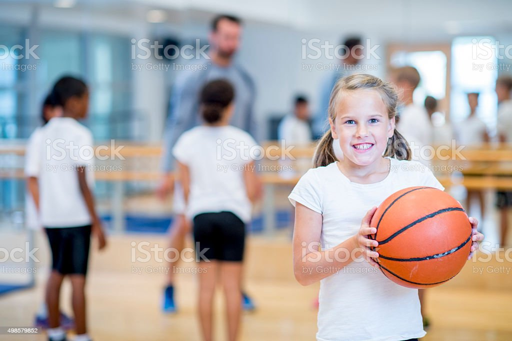 Playing Basketball at the Gym stock photo