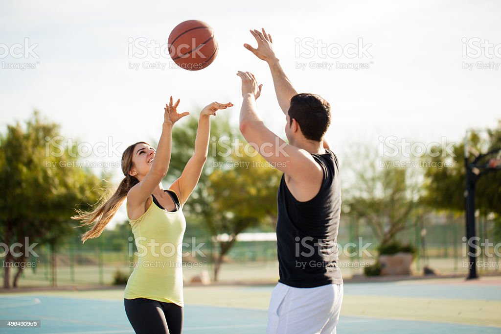 Playing basketball on a first date stock photo
