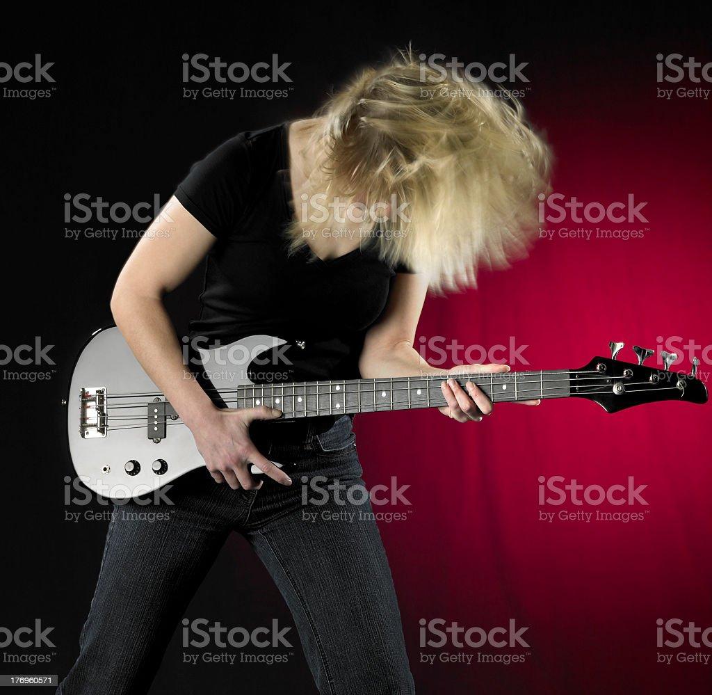 playing bass guitar stock photo