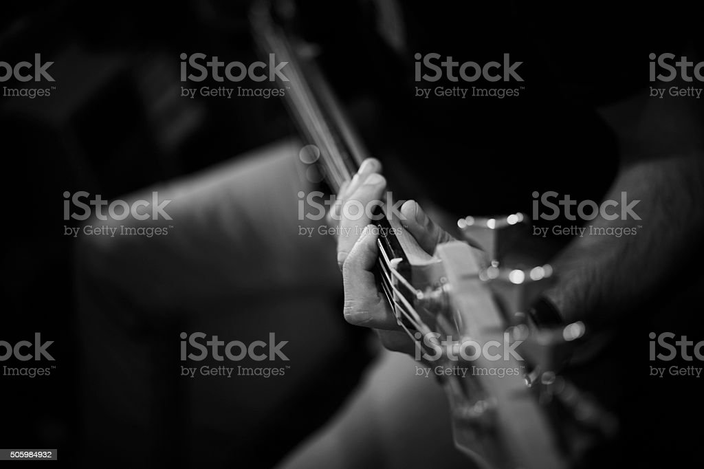 Playing Bass Guitar stock photo