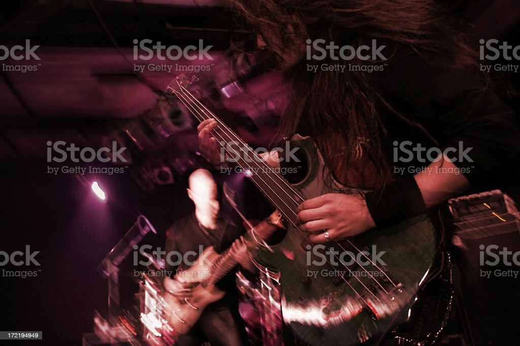 Playing bass on stage royalty-free stock photo