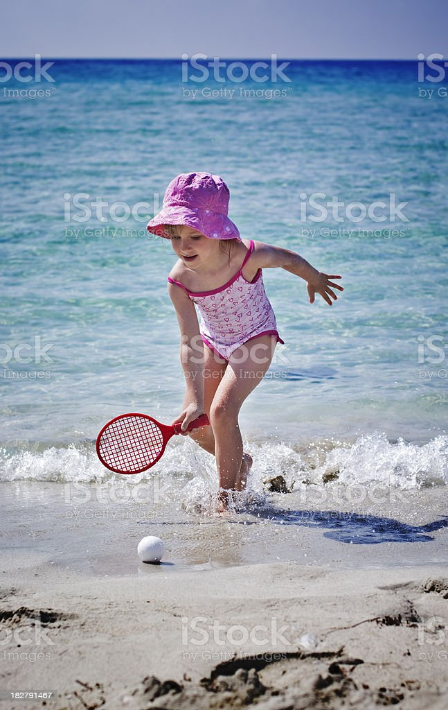 Playing beach racketball royalty-free stock photo