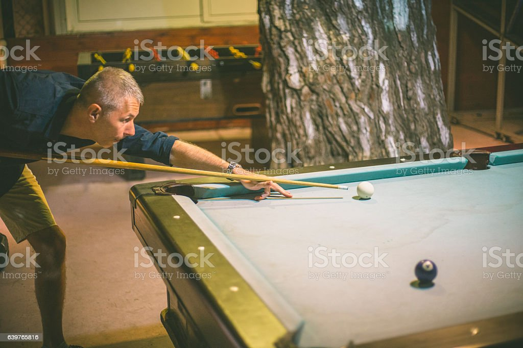 Playing billiard - Close-up shot of a man playing billiard stock photo