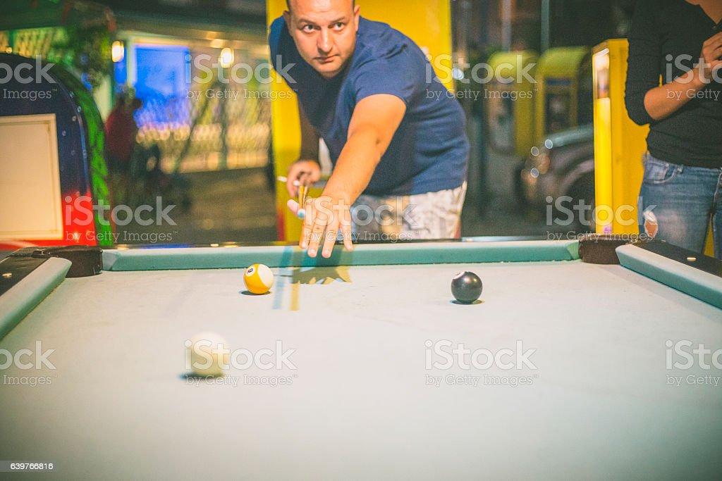 Playing billiard stock photo