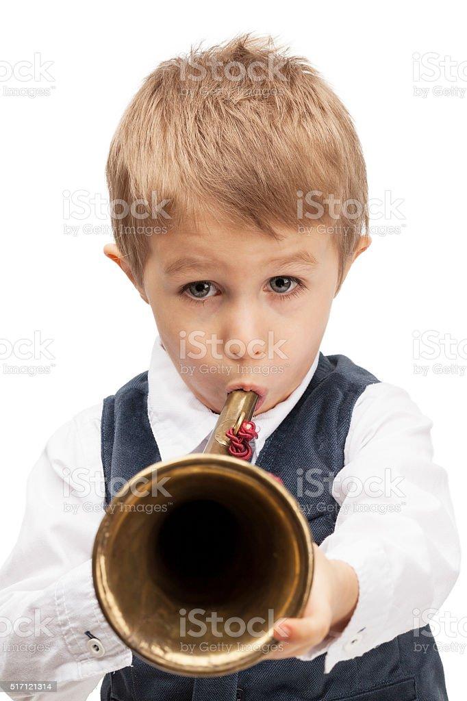 Playing bugle child stock photo
