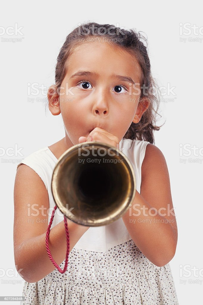 Playing bugle little girl stock photo