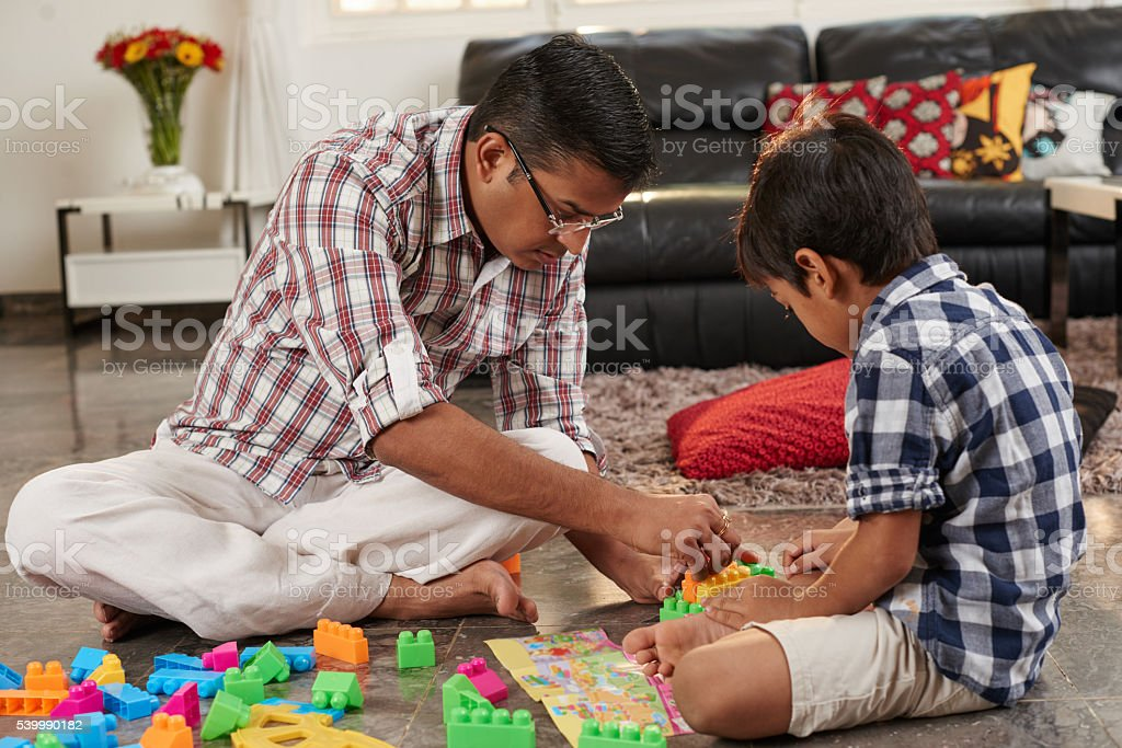 Playing building blocks stock photo