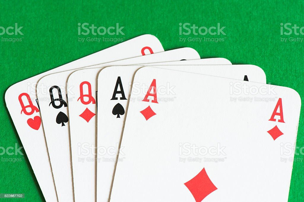Playing card on green table, Full house stock photo