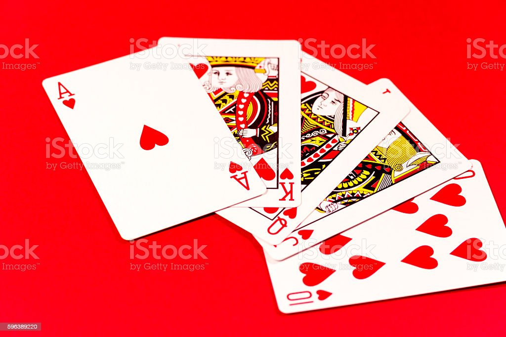 Playing card on red background stock photo