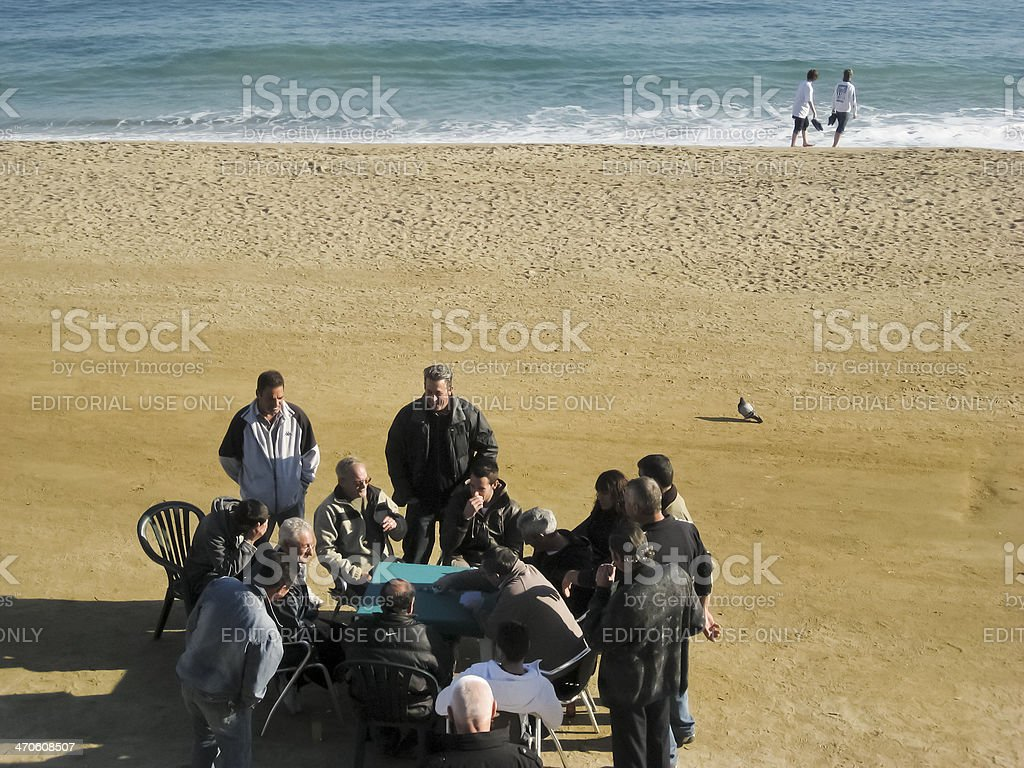 Playing cards in Barceloneta beach royalty-free stock photo