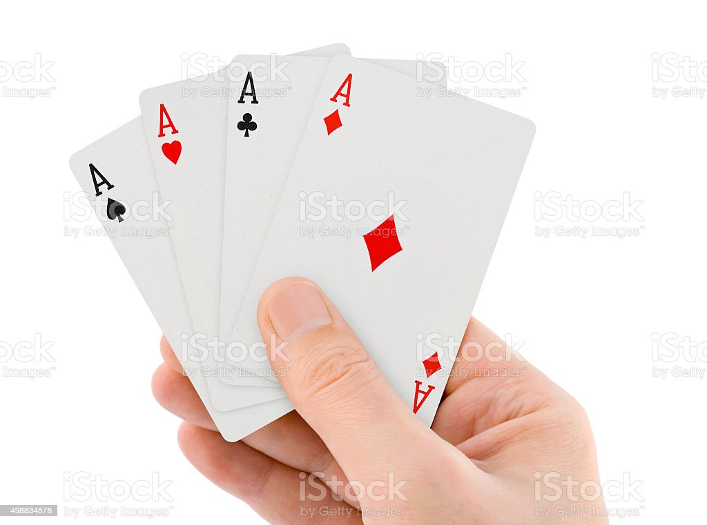 Playing cards in hand stock photo
