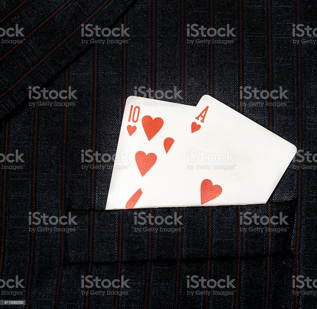 playing cards in pocket of suit stock photo