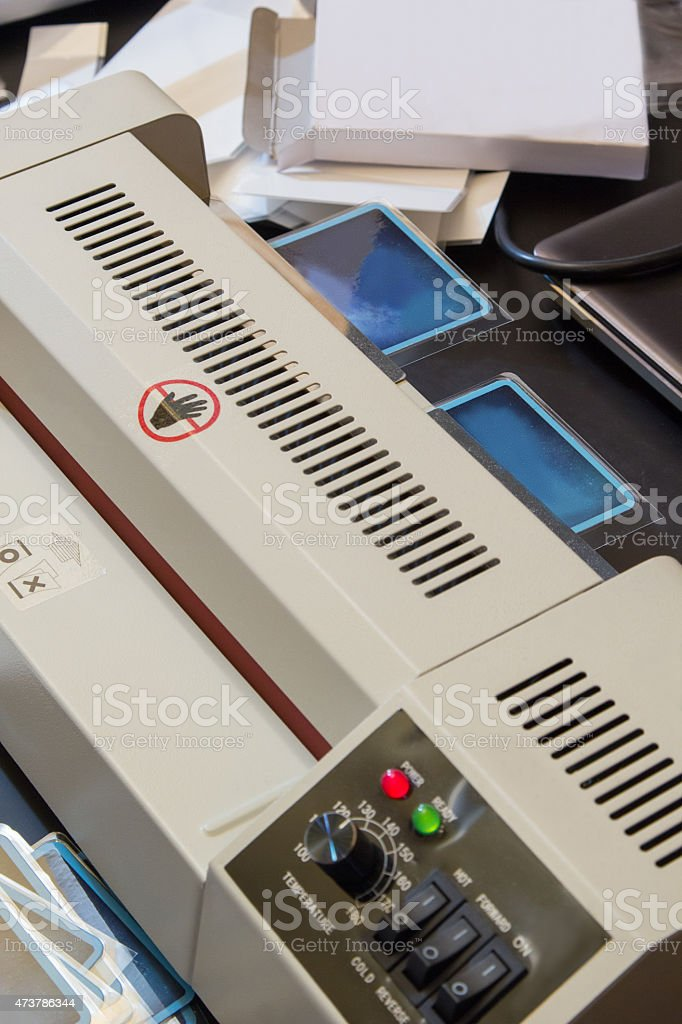 playing cards in the film rolled through a laminator stock photo