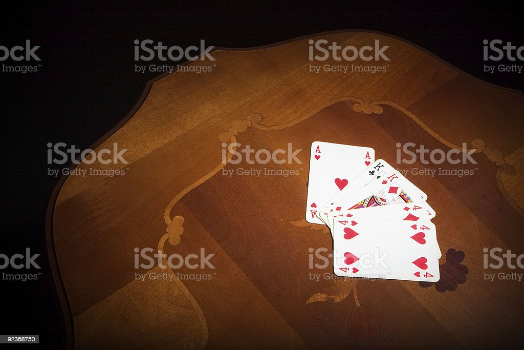 Playing cards on a table stock photo