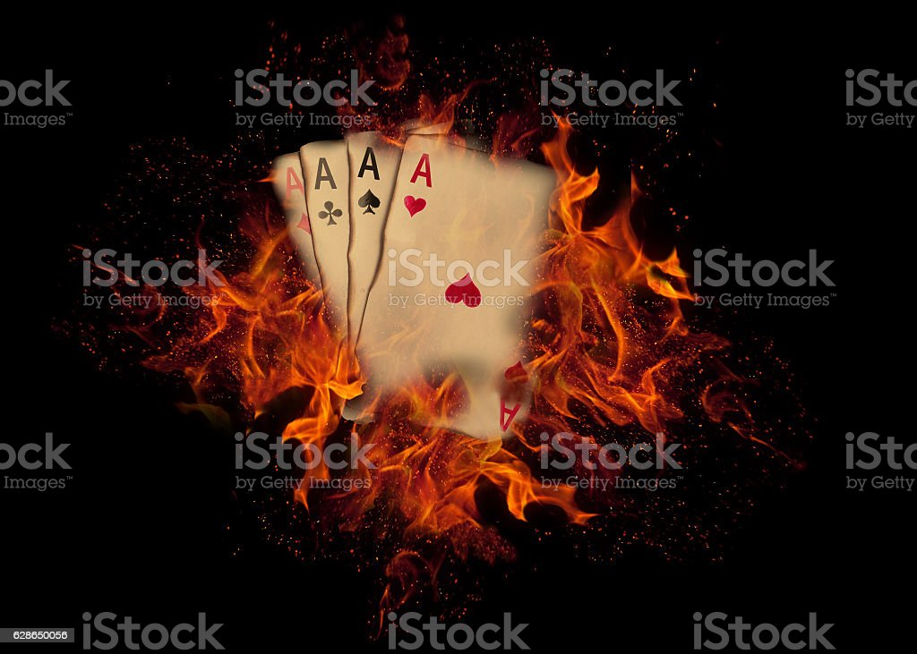 Playing cards on fire. casino concept stock photo