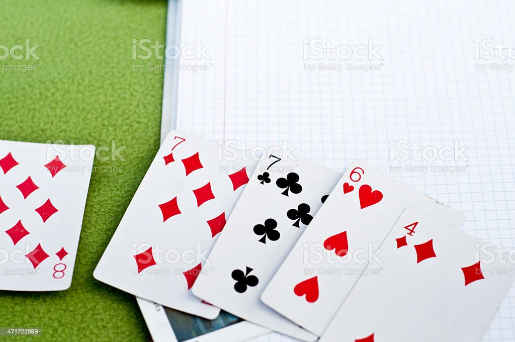 Playing cards on the notebook royalty-free stock photo