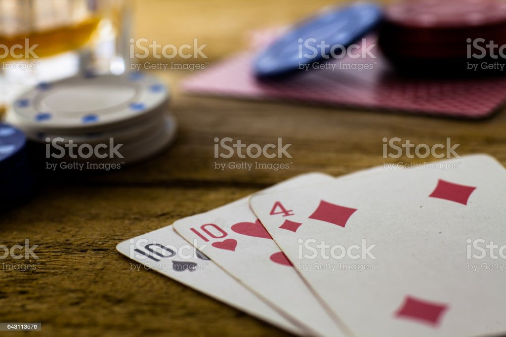 Playing Cards on wooden table stock photo
