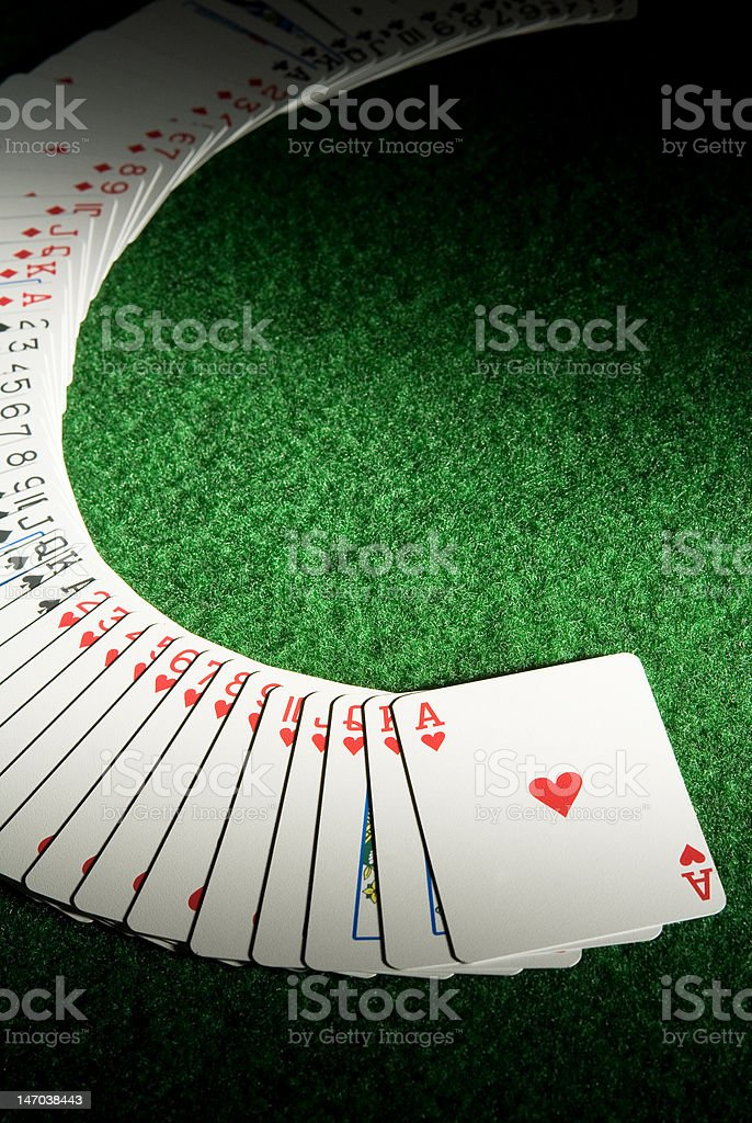 Playing cards spread out in arc stock photo
