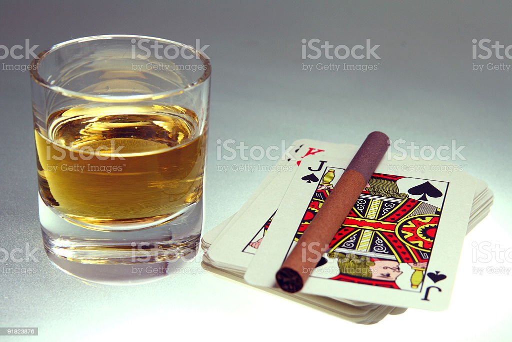 Playing cards with whiskey stock photo