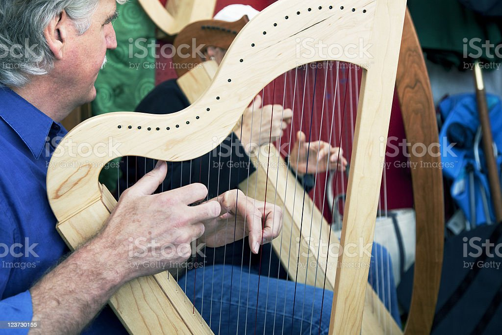 Playing Celtic Harp stock photo