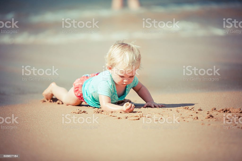 Playing cherfully in the sand stock photo