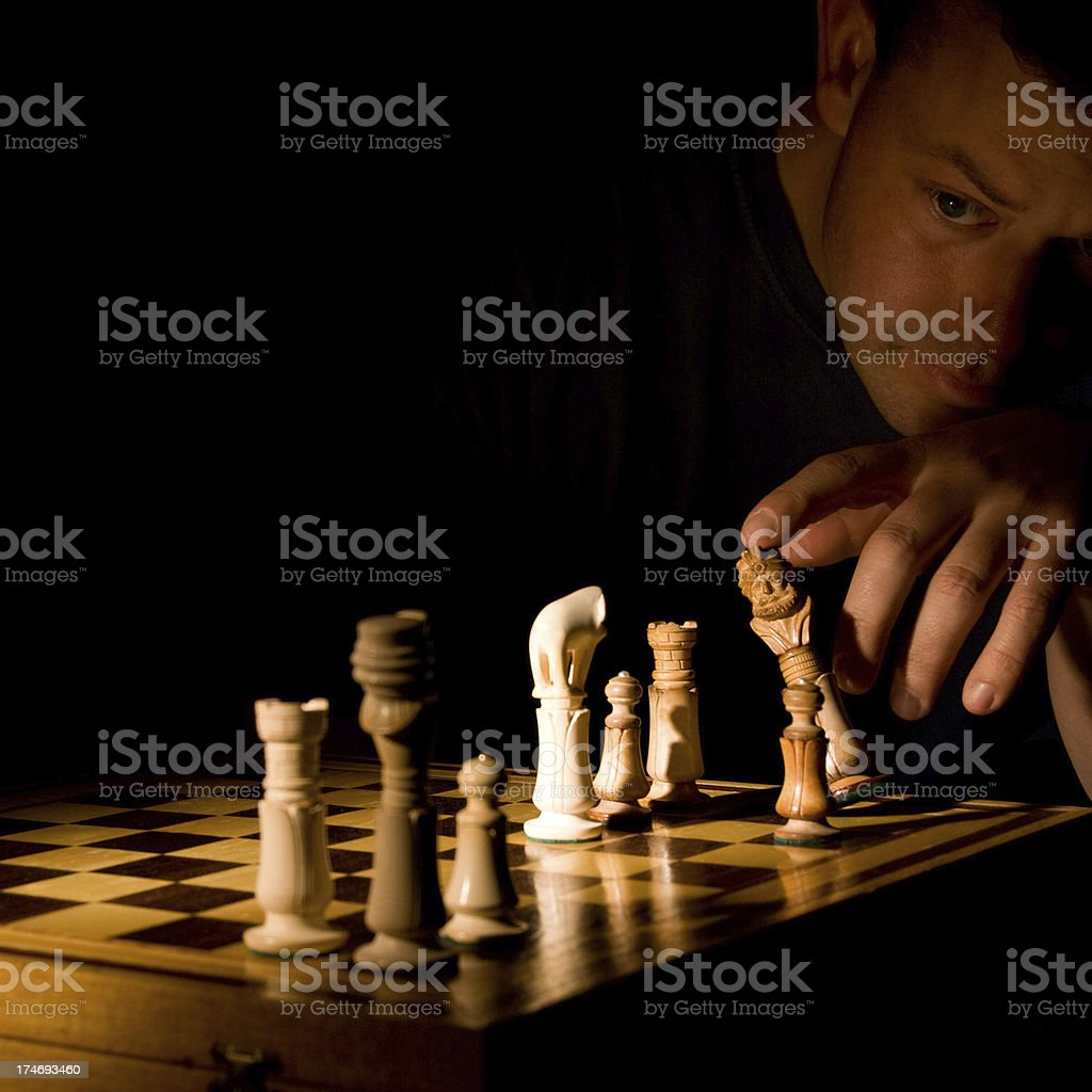 Playing chess in the dark royalty-free stock photo
