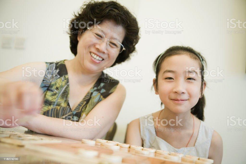 Playing chess with grandma stock photo