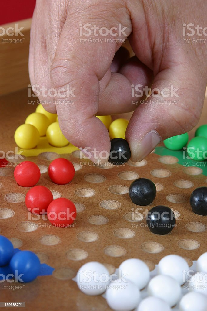 Playing Chinese Checkers stock photo