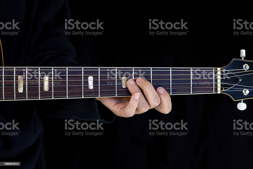 Playing Chord on Guitar royalty-free stock photo
