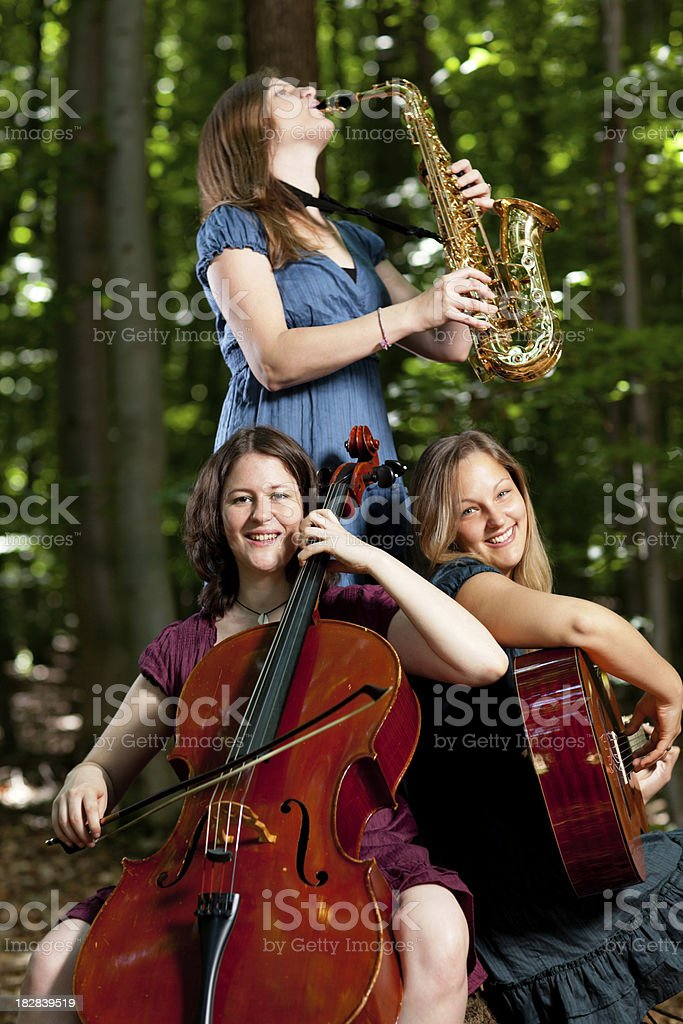 playing classical music in forest royalty-free stock photo