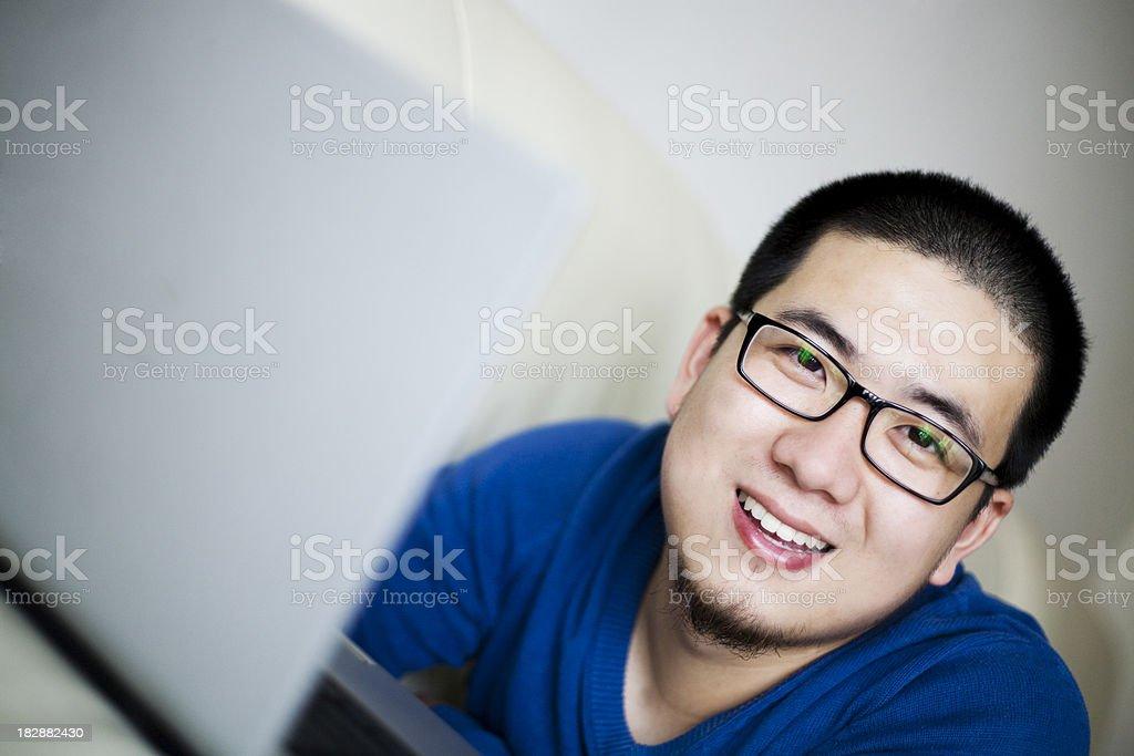 playing computer on sofa royalty-free stock photo