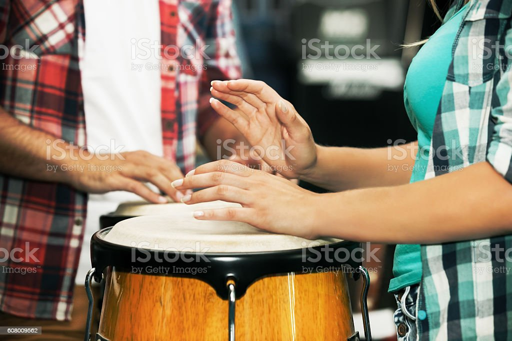 Playing congas. Close up. stock photo