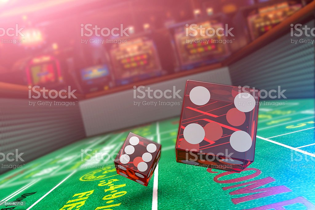 Playing Craps in a Casino with Slot Machines stock photo