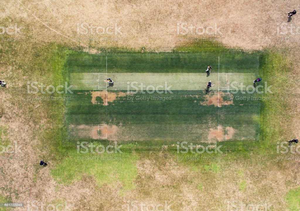 Playing Cricket. stock photo