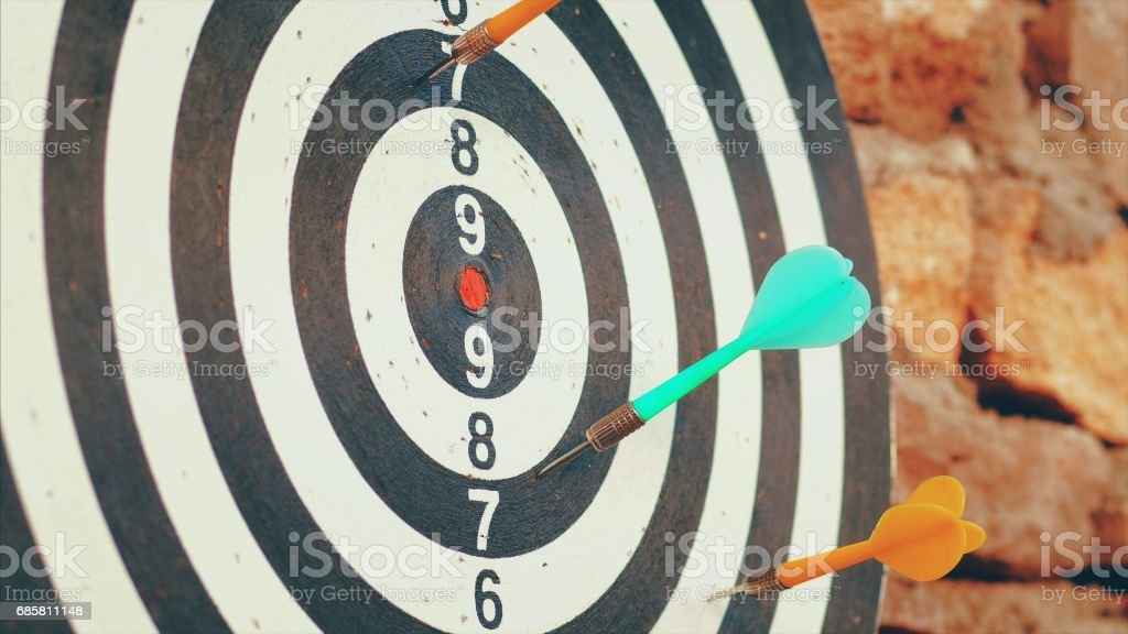 Playing darts. Hitting board stock photo