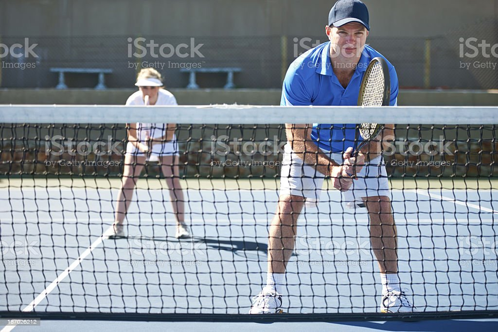 Playing doubles means working together royalty-free stock photo