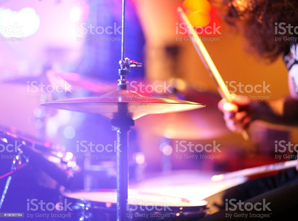 Playing drum on stage stock photo