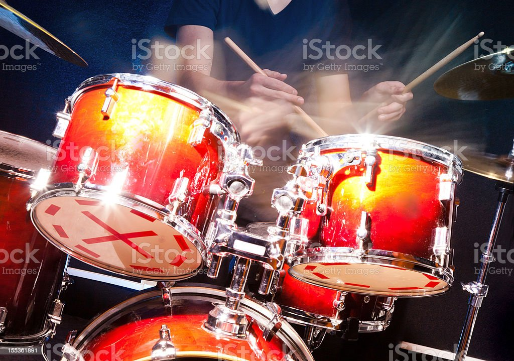 Playing drums action stock photo