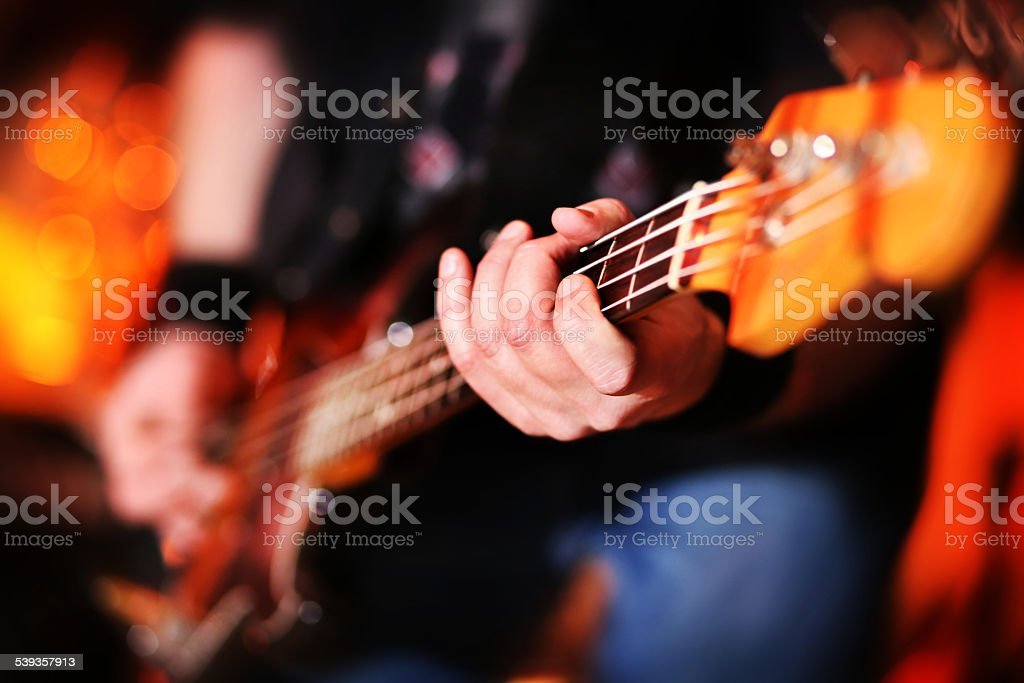 Playing electric bass guitar stock photo