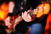 Playing electric bass guitar