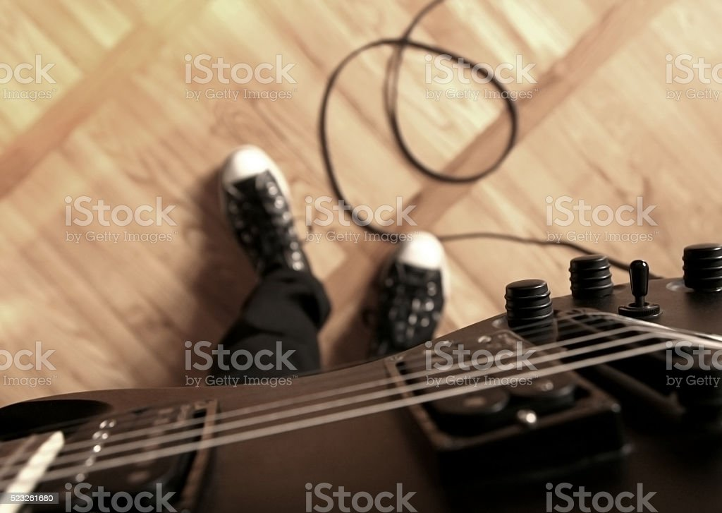 Playing electric guitar. First person perspective. stock photo